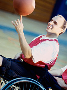 Guy in wheelchair spinning basketball on finger